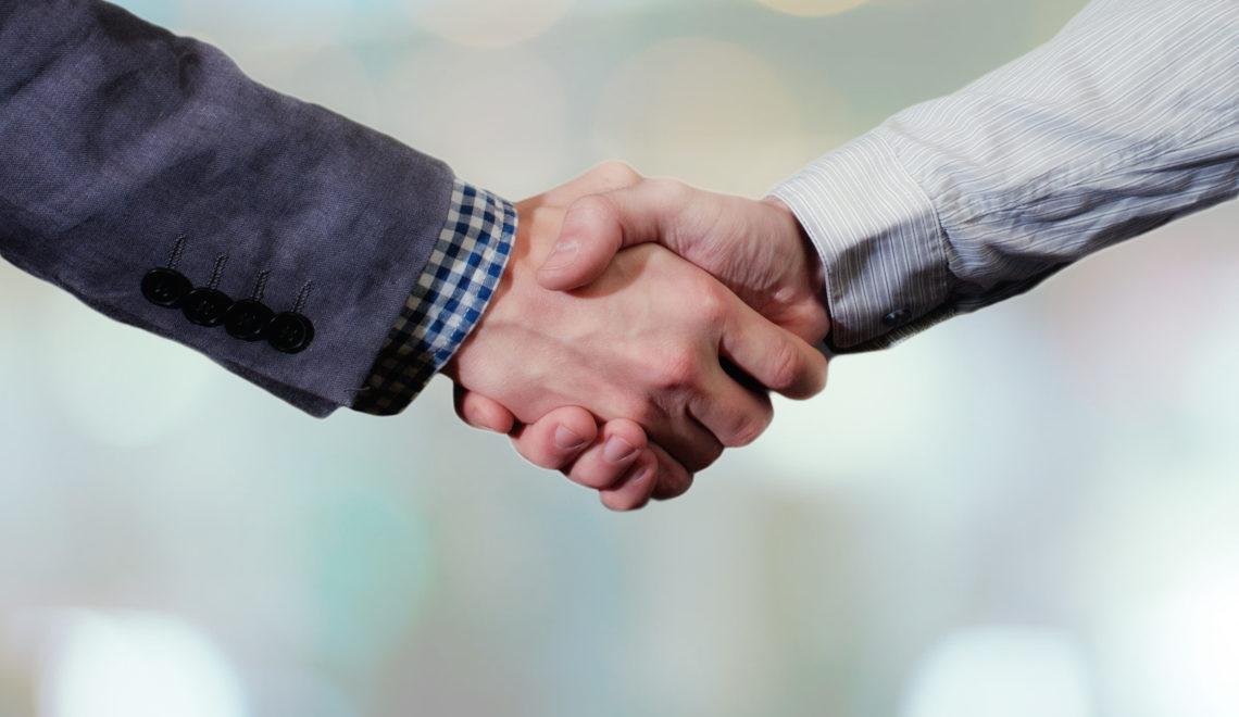 Handschlag zur Einigung